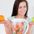 charming woman with a blender and fruits looking at an apple stock photo © wavebreak_media