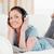 portret · glimlachende · vrouw · hoofdtelefoon · home · vrouw · muziek - stockfoto © wavebreak_media