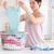Cute Woman folding clothes in a utility room stock photo © wavebreak_media