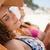 güzel · bir · kadın · güverte · sandalye · plaj · deniz · arkadaşlar - stok fotoğraf © wavebreak_media