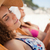 bela · mulher · convés · cadeira · praia · mar · amigos - foto stock © wavebreak_media