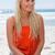 femme · séance · sable · regarder · ciel · plage - photo stock © wavebreak_media