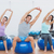 sporty people stretching up hands on exercise balls at gym stock photo © wavebreak_media