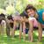 group of fitness people doing push ups in park stock photo © wavebreak_media