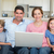 portré · boldog · család · laptopot · használ · nappali · otthon · nő - stock fotó © wavebreak_media