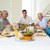 Family having meal together at dining table stock photo © wavebreak_media