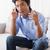 annoyed man sitting on couch talking on phone stock photo © wavebreak_media