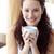 Beautiful woman drinking a cup of coffee in bedroom stock photo © wavebreak_media