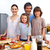 happy family having a breakfast in the kitchen stock photo © wavebreak_media