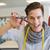 Smiling student holding pair of scissors stock photo © wavebreak_media