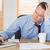 frustrato · imprenditore · seduta · desk · ufficio · utilizzando · il · computer · portatile - foto d'archivio © wavebreak_media