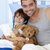 父から息子 · 演奏 · 医師 · ベッド · テディベア · 笑顔 - ストックフォト © wavebreak_media