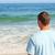 przystojny · mężczyzna · uśmiechnięty · plaży · młodych · stałego - zdjęcia stock © wavebreak_media