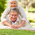 mature couple lying down in the park stock photo © wavebreak_media
