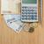 калькулятор · монетами · черный · доллара · изолированный - Сток-фото © wavebreak_media