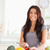 Pretty woman cooking vegetables while standing in the kitchen stock photo © wavebreak_media