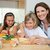 mother making sandwiches together with her children stock photo © wavebreak_media