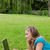 widok · z · boku · młodych · student · za · pomocą · laptopa · trawy · parku - zdjęcia stock © wavebreak_media