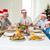 Happy family in Santa hats having Christmas meal stock photo © wavebreak_media