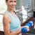 fit brunette lifting blue dumbbells stock photo © wavebreak_media