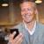 анонимный · бизнесмен · смартфон · серый · человека · окна - Сток-фото © wavebreak_media