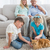 Smiling family with their ginger cat on the rug stock photo © wavebreak_media