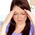 Young woman with headache at home in the living-room stock photo © wavebreak_media