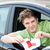 Happy young man cutting a 'L' sign sitting in his car stock photo © wavebreak_media
