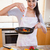 portrait of a woman preparing a dish in her kitchen stock photo © wavebreak_media
