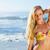 Gorgeous blonde in bikini standing on the beach stock photo © wavebreak_media