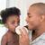 happy father trying to feeding his baby girl stock photo © wavebreak_media
