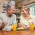 feliz · casal · de · idosos · café · da · manhã · casa · família · tecnologia - foto stock © wavebreak_media