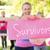 survivors against smiling women running for breast cancer awaren stock photo © wavebreak_media