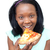 Cheerful young woman eating a pizza  stock photo © wavebreak_media
