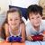 siblings playing video games together stock photo © wavebreak_media