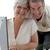 feliz · pareja · de · ancianos · casa · ordenador · casa - foto stock © wavebreak_media