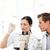 bilim · adamları · bakıyor · slayt · mikroskop · genç · kadın - stok fotoğraf © wavebreak_media
