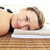 portrait of a young woman lying on a massage table with hot stones in a health spa stock photo © wavebreak_media