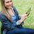 fiatal · boldog · lány · néz · kamera · megérint · táblagép - stock fotó © wavebreak_media