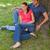 dos · mujeres · sonriendo · sesión · hierba · ciudad - foto stock © wavebreak_media