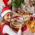 portrait of cute girl in santa hat during christmas dinner stock photo © wavebreak_media