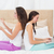 pretty friends using their technology on bed stock photo © wavebreak_media