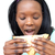 Afro-american young woman eating a sandwich  stock photo © wavebreak_media