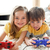 adorable siblings playing video game stock photo © wavebreak_media