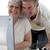 pareja · de · ancianos · casa · sonriendo · ordenador · casa - foto stock © wavebreak_media