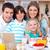 Joyful family using laptop during the breakfast in the kitchen stock photo © wavebreak_media