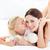 bonitinho · little · girl · beijando · mãe · cama · família - foto stock © wavebreak_media