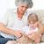 grandmother helping her little girl to knit stock photo © wavebreak_media