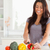 attractive female cooking vegetables while standing in the kitchen stock photo © wavebreak_media