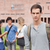 Lonely male student posing while his classmates are talking outside a building stock photo © wavebreak_media